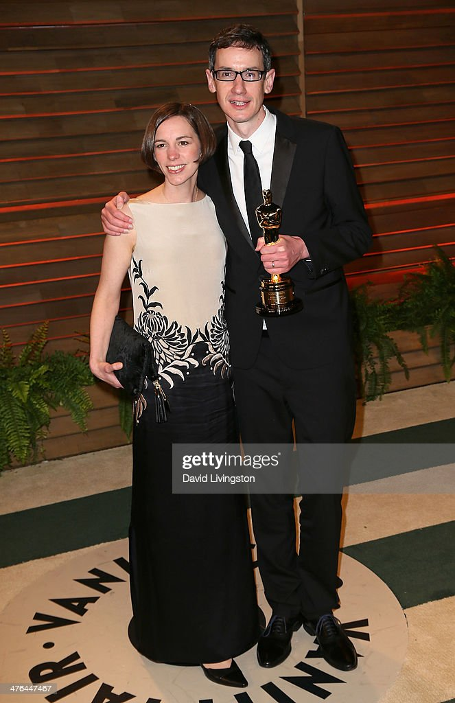 Composer Steven Price (R) and wife Gemma Price attend the 2014 Vanity Fair Oscar Party hosted by Graydon Carter on March 2, 2014 in West Hollywood, California.