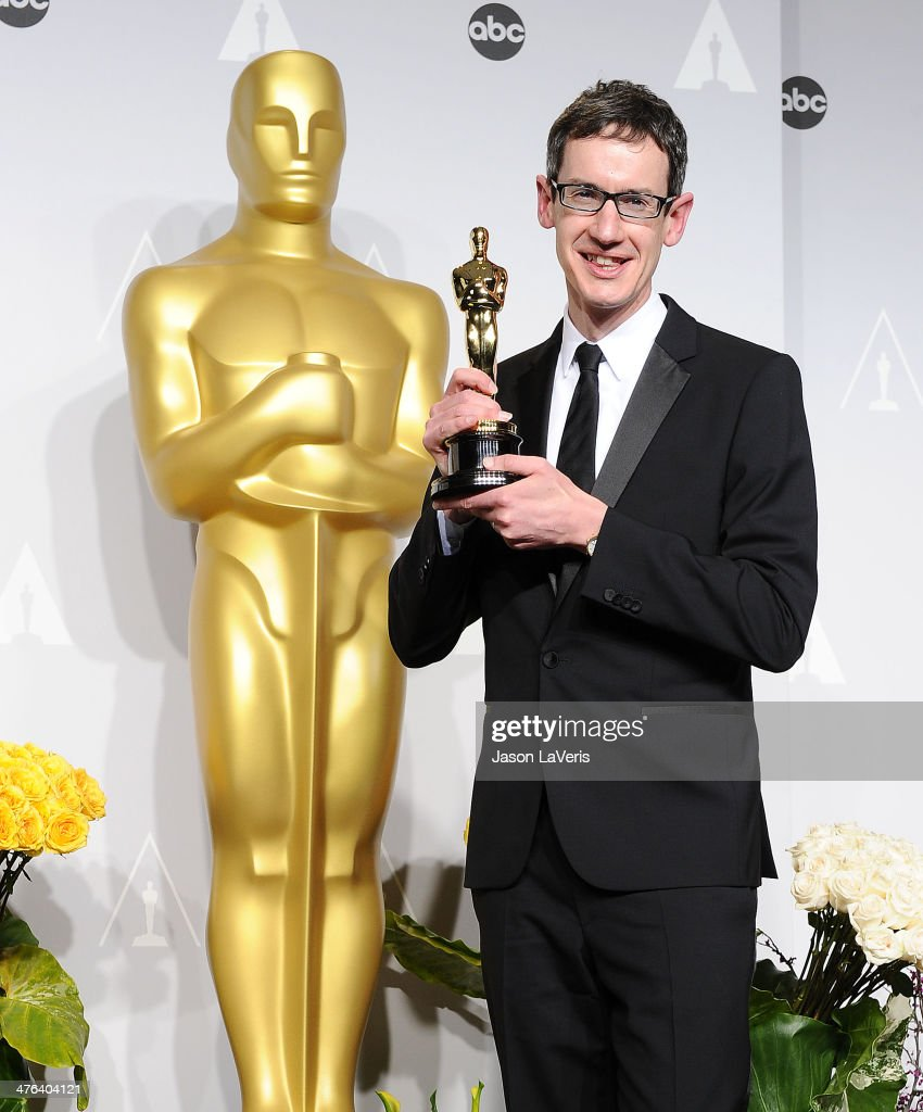 Composer Steven Price poses in the press room at the 86th annual Academy Awards at Dolby Theatre on March 2, 2014 in Hollywood, California.