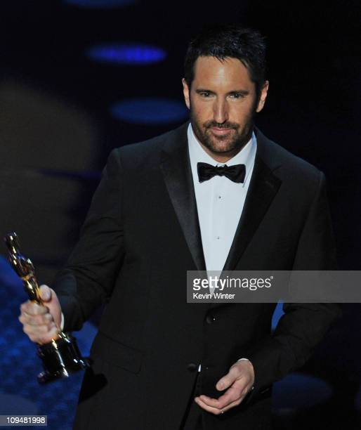 Composer Trent Reznor accepts the award for Best Original Score for 'The Social Network' onstage during the 83rd Annual Academy Awards held at the...