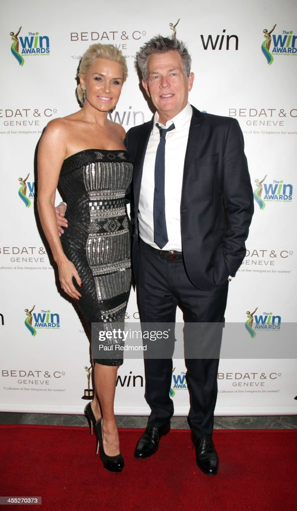 Composer/producer <a gi-track='captionPersonalityLinkClicked' href=/galleries/search?phrase=David+Foster&family=editorial&specificpeople=210611 ng-click='$event.stopPropagation()'>David Foster</a> (R) and his wife, TV personality/model Yolanda Foster arrive at The Annual Women's Image Awards at Santa Monica Bay Woman's Club on December 11, 2013 in Santa Monica, California.
