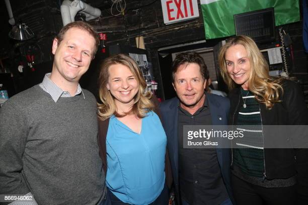 Composers and writers of 'Come From Away' David Hein Irene Sankoff Michael J Fox and Tracy Pollan pose backstage with the cast of the hit musical...