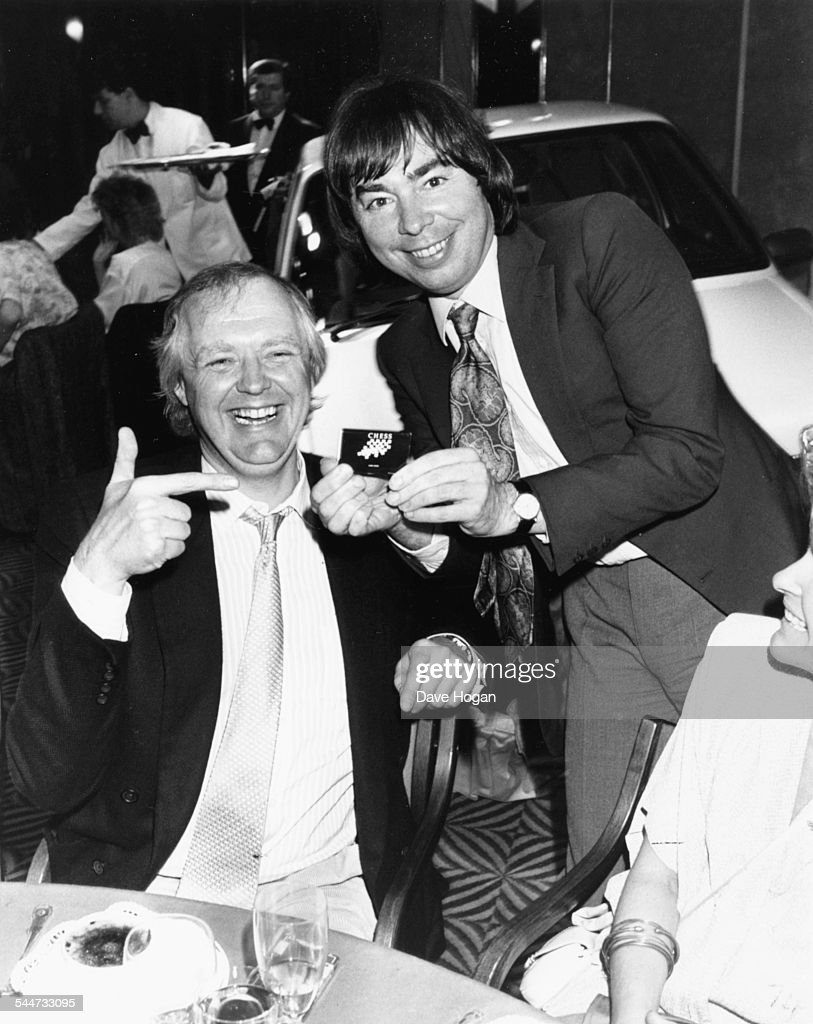Composers Tim Rice and Andrew Lloyd Webber joking around at a charity luncheon in aid of music therapy at London Intercontinental Hotel June 28th 1985