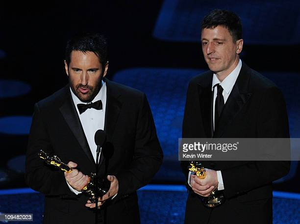 Composers Trent Reznor and Atticus Ross accept the award for Best Original Score for 'The Social Network' onstage during the 83rd Annual Academy...