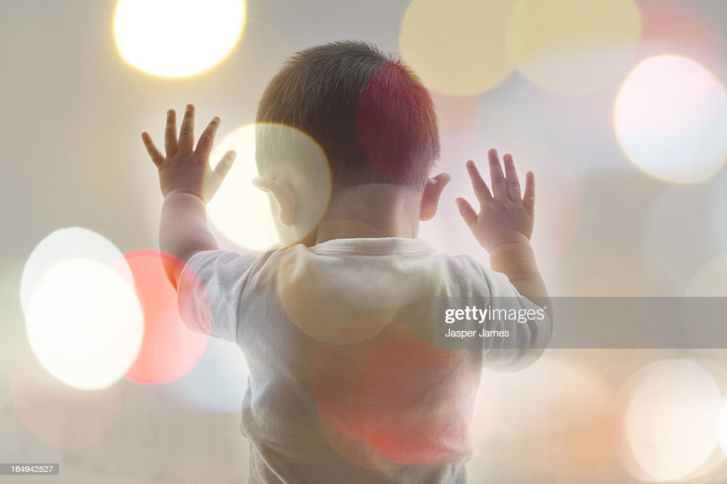 composite image of baby and blurred lights : Stock Photo