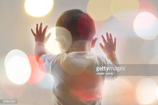 composite image of baby and blurred lights