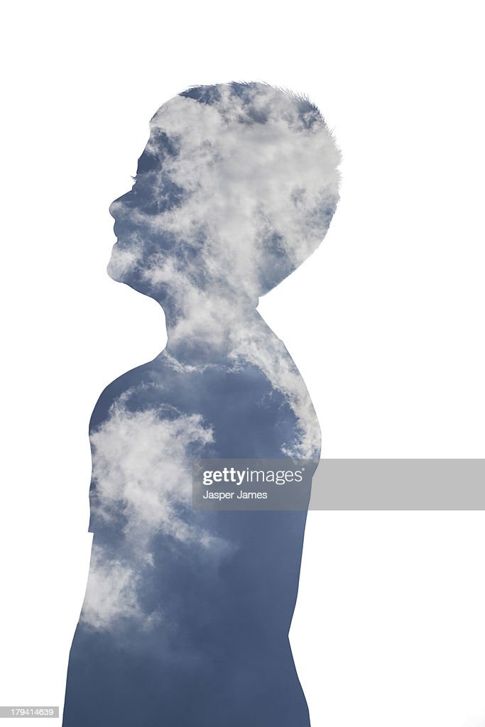 composite image of boy and blue sky and clouds : Stock Photo