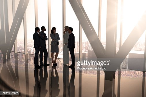 Composite image of business colleagues talking : Foto de stock