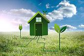 Clean energy house against sunny landscape