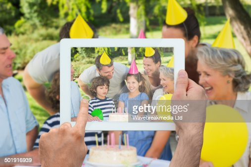 Composite image of hand holding tablet pc : Foto stock