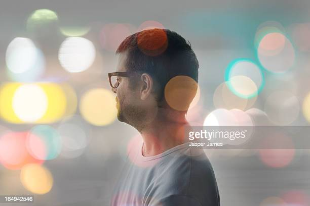 composite image of man and blurred lights