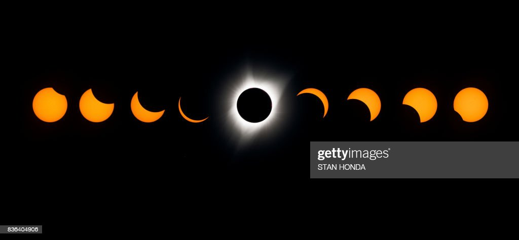 TOPSHOT - A composite image of the total solar eclipse seen from the Lowell Observatory Solar Eclipse Experience August 21, 2017 in Madras, Oregon. /