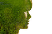 composite image of womans head and green grass