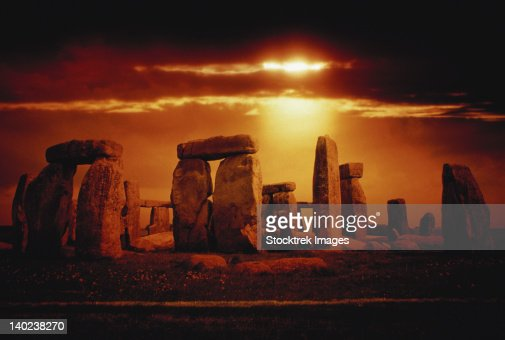 Composite of a sunset over Stonehenge, Wiltshire, England. : Stock-Foto