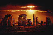 Composite of a sunset over Stonehenge, Wiltshire, England.