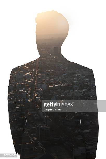 composite of businessman and cityscape