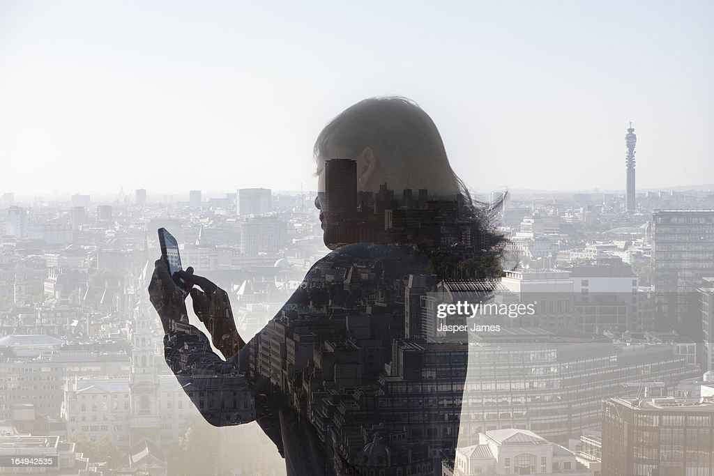 composite of cityscape and woman using phone : Stock Photo