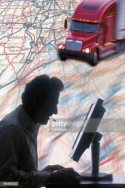 Composite of dispatcher on computer with truck on road map