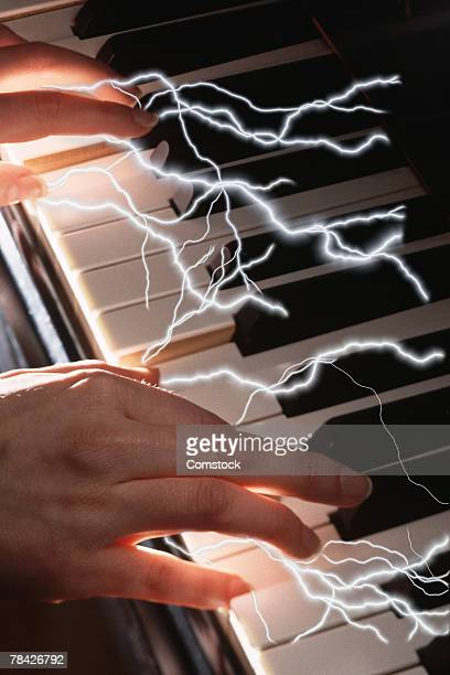 Composite of lightning bolts and hands playing piano