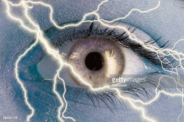 Composite of lightning bolts and human eye