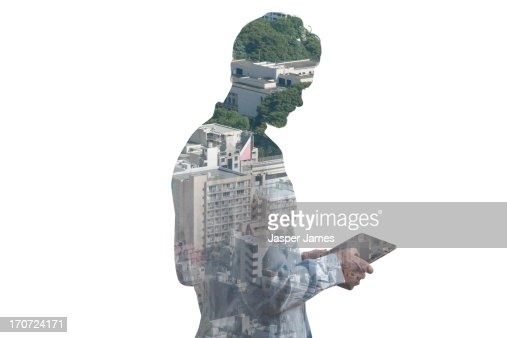 composite of man using ipad and cityscape : Stock Photo
