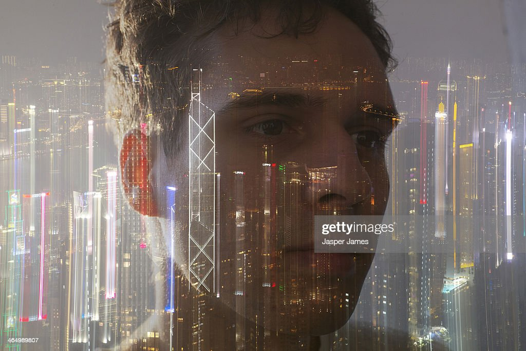 composite of mans face and night cityscape : Stock Photo