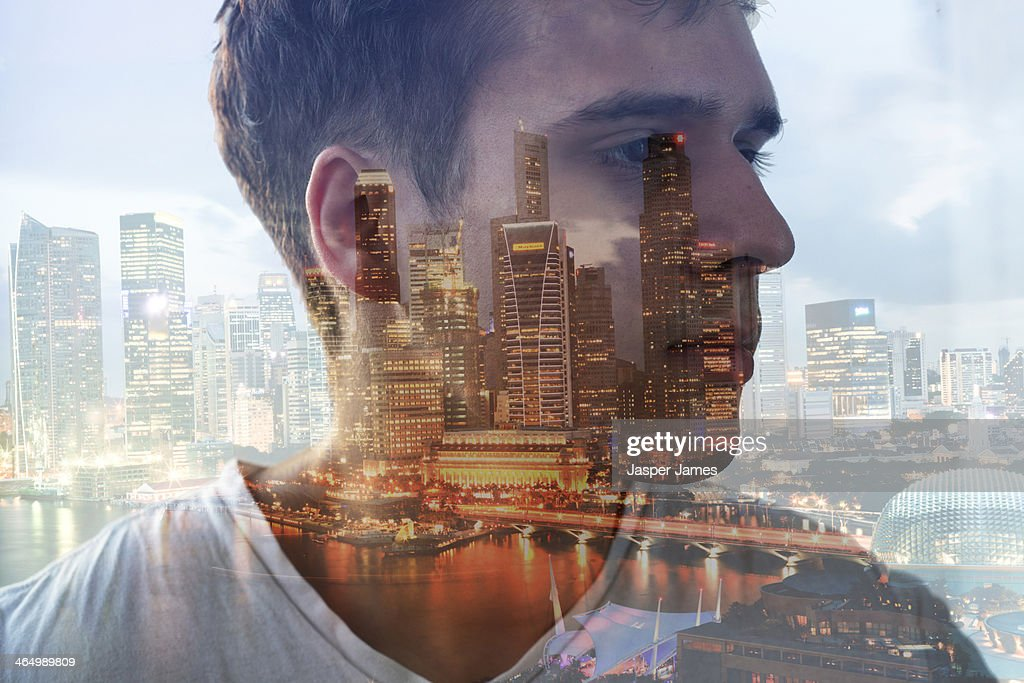 composite of mans head and cityscape