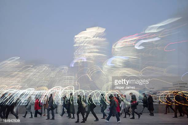 composite of people walking and cityscape