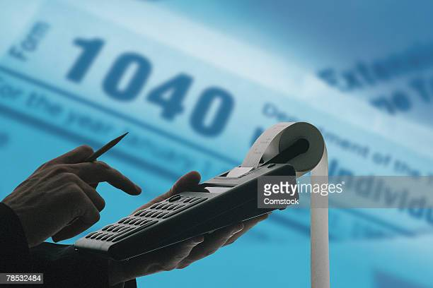 Composite of person with calculator and tax forms