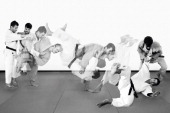 Composite of two judo experts executing a throw taken on September 4 2013