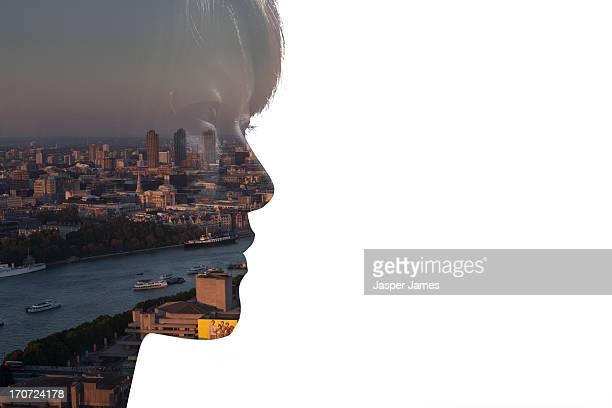 composite of womans face and cityscape