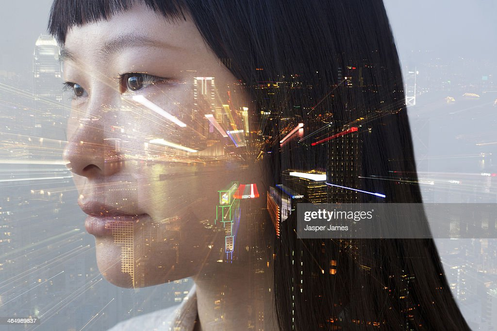 composite of woman's face and cityscape : Stock Photo