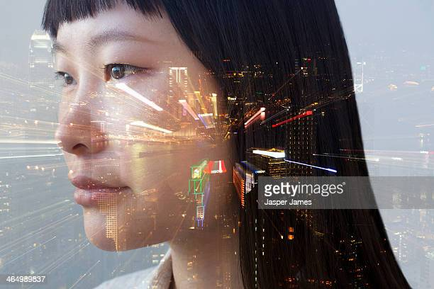 composite of woman's face and cityscape