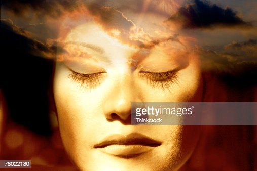 Composite of woman's face and sky : Stock Photo