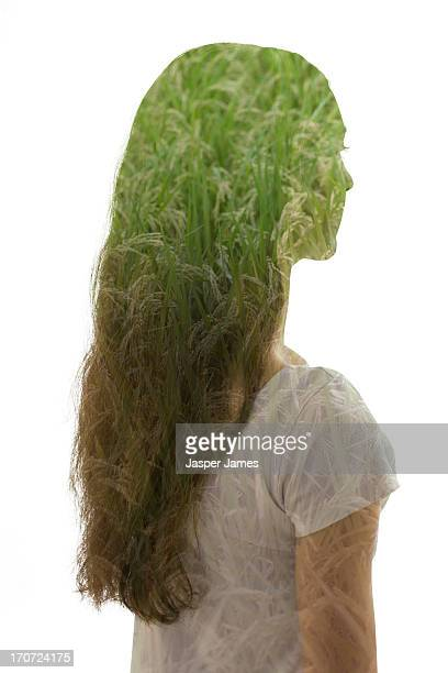 composite of young woman and green grass