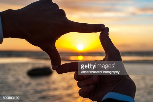 Composition finger frame- man's hands capture the sunset : Stock Photo