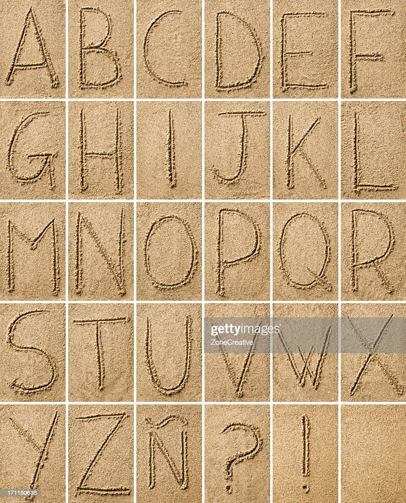 composition of alphabet characters  drawn on sand