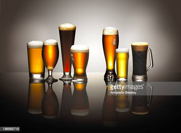 A Composition of Frothy Beers in Beer Glasses
