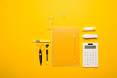 composition of yellow school supplies and calculator