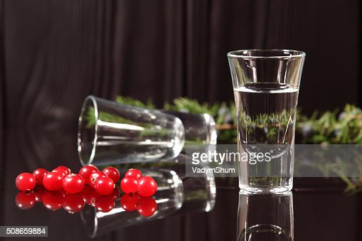 Composition of two glasses with alcohol and red berries cranberries : Stock Photo