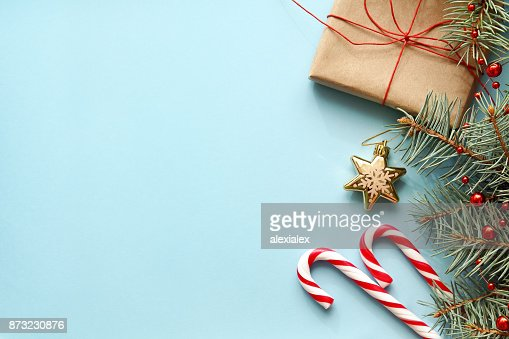 Composition with Christmas gift box, fir tree branch, candy canes. : Stock Photo
