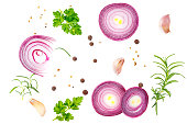 Composition with red onion and spices isolated on white background. Top view.