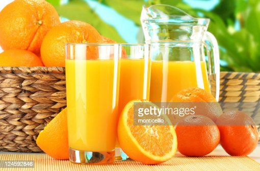Composition with two glasses of orange juice and fruits : Stock Photo