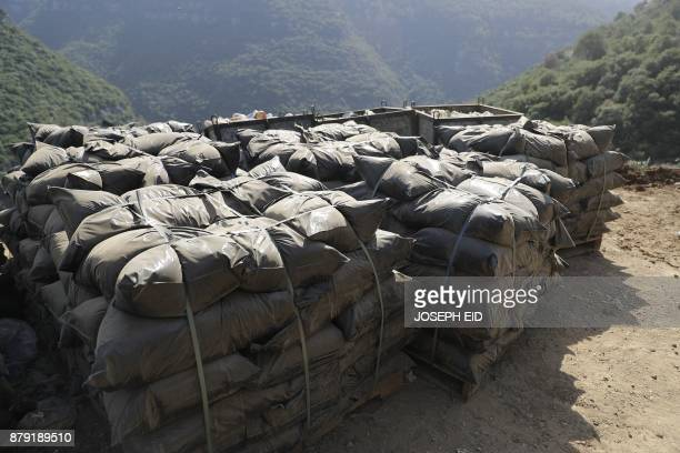 Compost bags are sen piled at a waste treatment plant in the area of Monteverde east of Beirut on October 27 2017 The Lebanese divers plunge below...