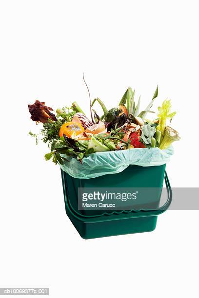 Compost in bucket on white background