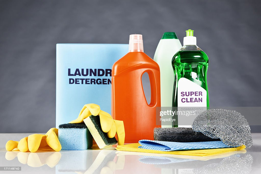 Comprehensive collection of domestic cleaning materials on black : Stock Photo