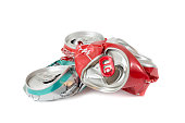 Pile of compressed cans isolated on a white background. Recyclable garbage series.
