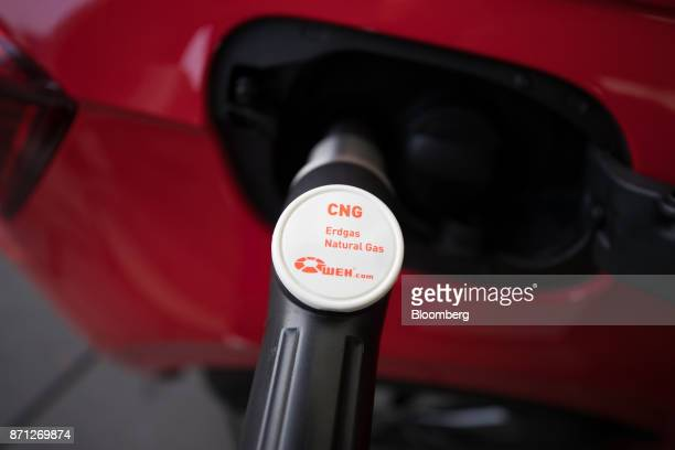 A compressed natural gas fuel pump fills a Volkswagen AG Polo TGI automobile at a petrol station forecourt during the VW CNG Mobility Day in Essen...