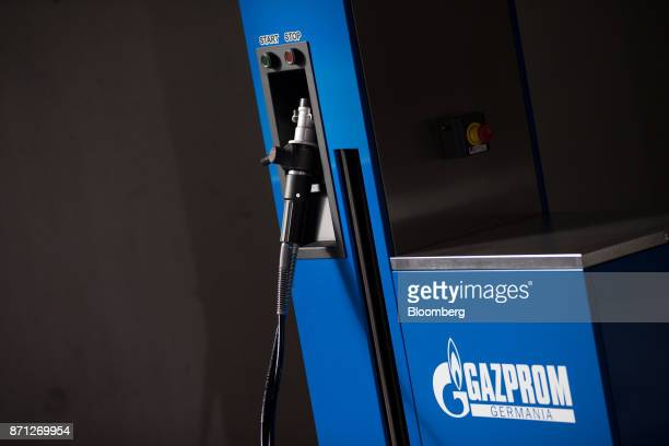 A compressed natural gas fuel pump operated by Gazprom Neft PJSC sits on display during the Volkswagen AG CNG Mobility Day in Essen Germany on...
