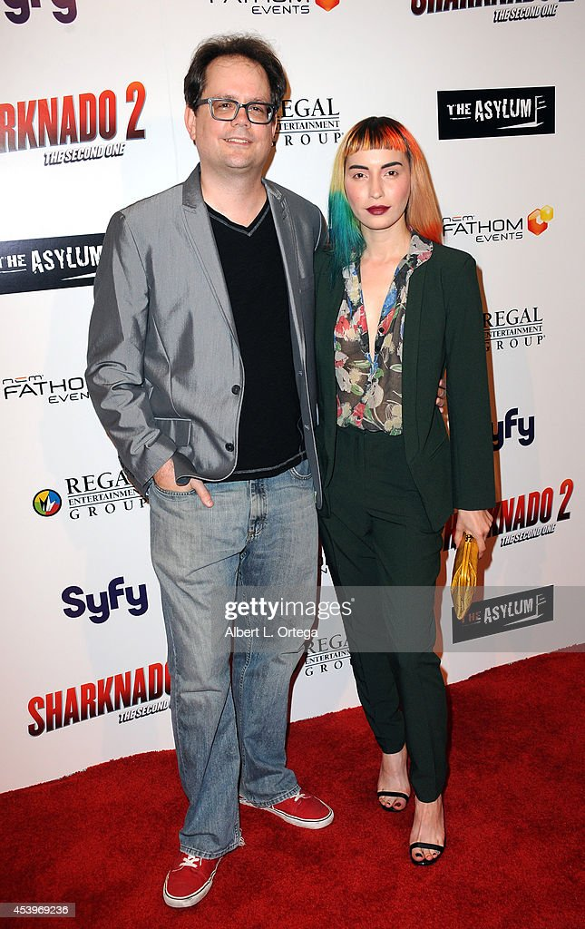 Compsoer Chris Ridenhour and Cassandra Church arrive for the Premiere Of The Asylum & Fathom Events' 'Sharknado 2: The Second One' held at Regal Cinemas L.A. Live on August 21, 2014 in Los Angeles, California.