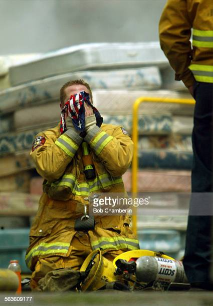 Compton Firefighter Sean Halvorson dropped to his knees for a rest and wiped his face with a patriotic bandana as he and others battled a stubborn...